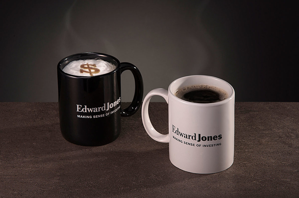 Edward Jones coffee mugs with dollar sign visible in the foam of one of the coffees