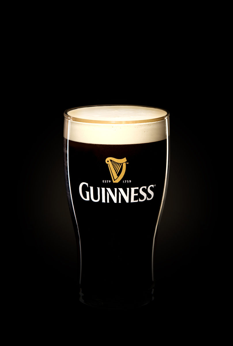 Guinness glass with foamy head