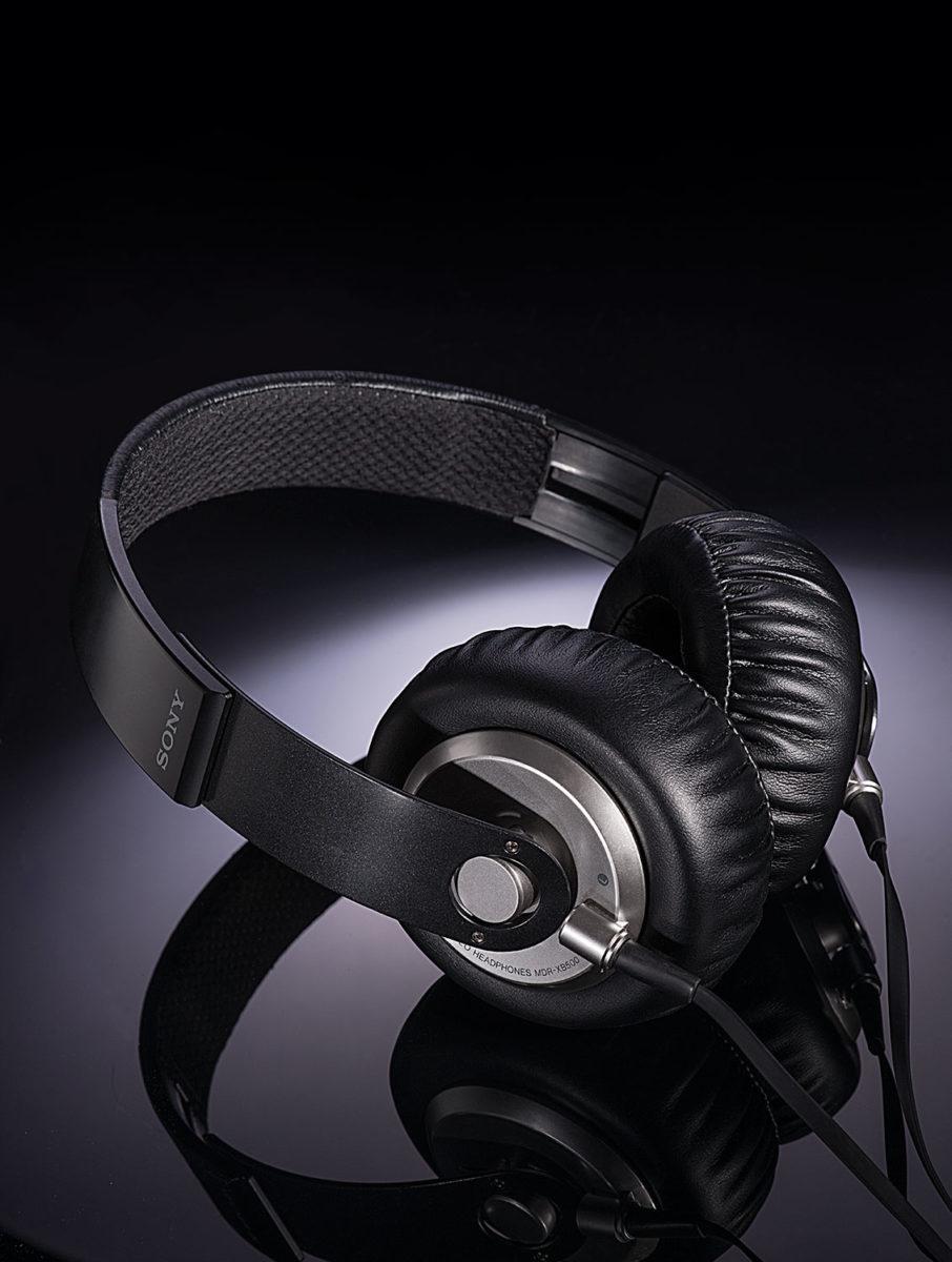 studio photograph of Sony headphones on a reflective black surface