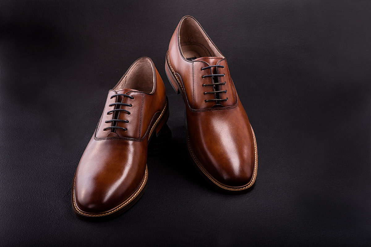 Commercial studio photograph of mens brown dress shoes