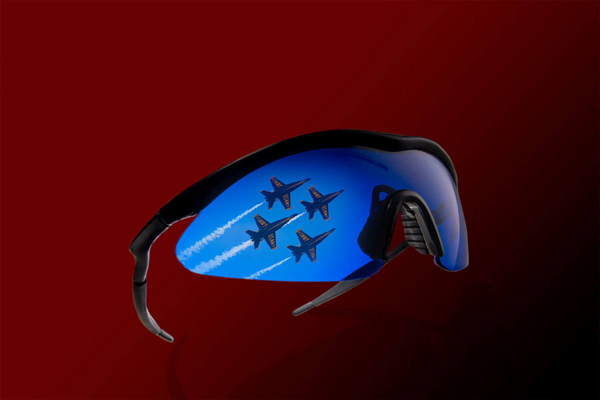 Blue sport sunglasses with Blue Angles reflecting off the front lens