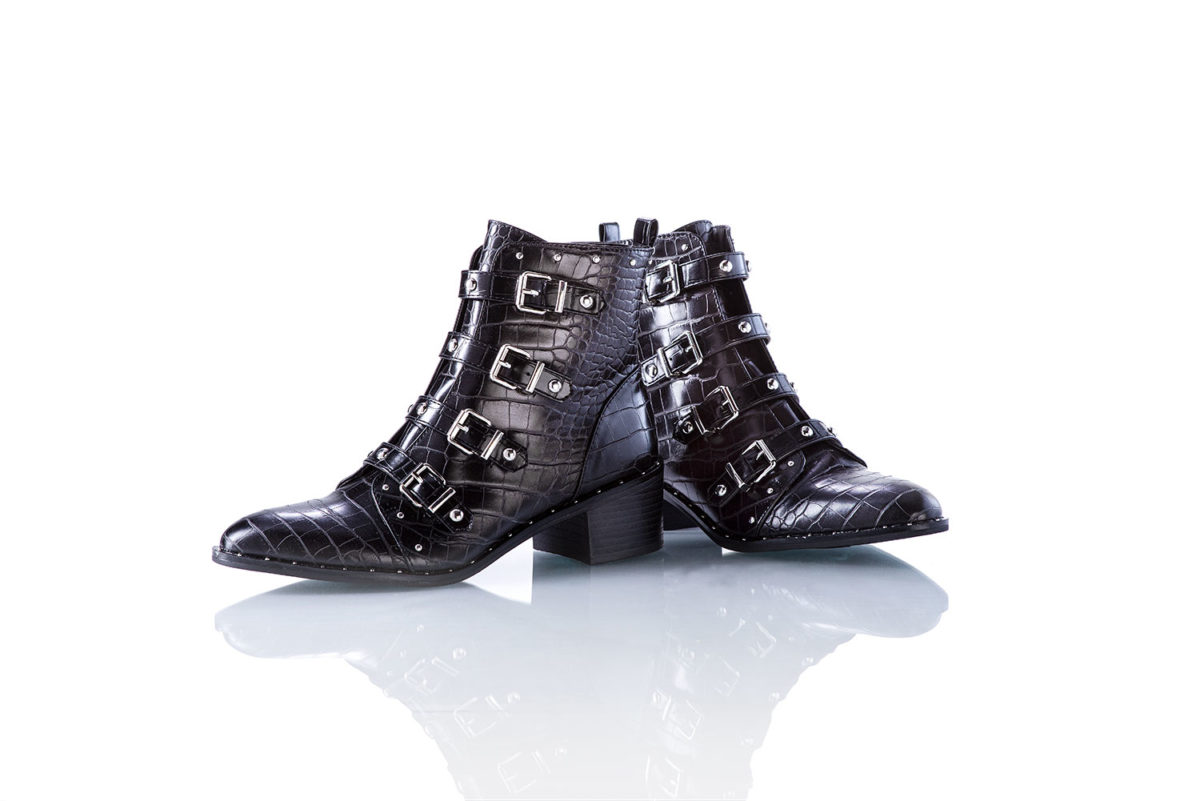 Women's black ankle boots with silver buckles on white background