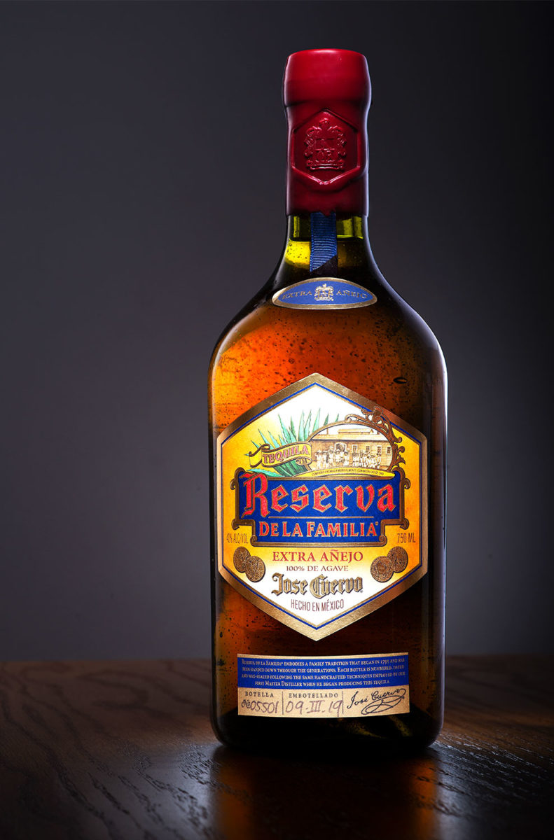 Jose Cuervo Reserva Extra Añejo bottle on a wooden table