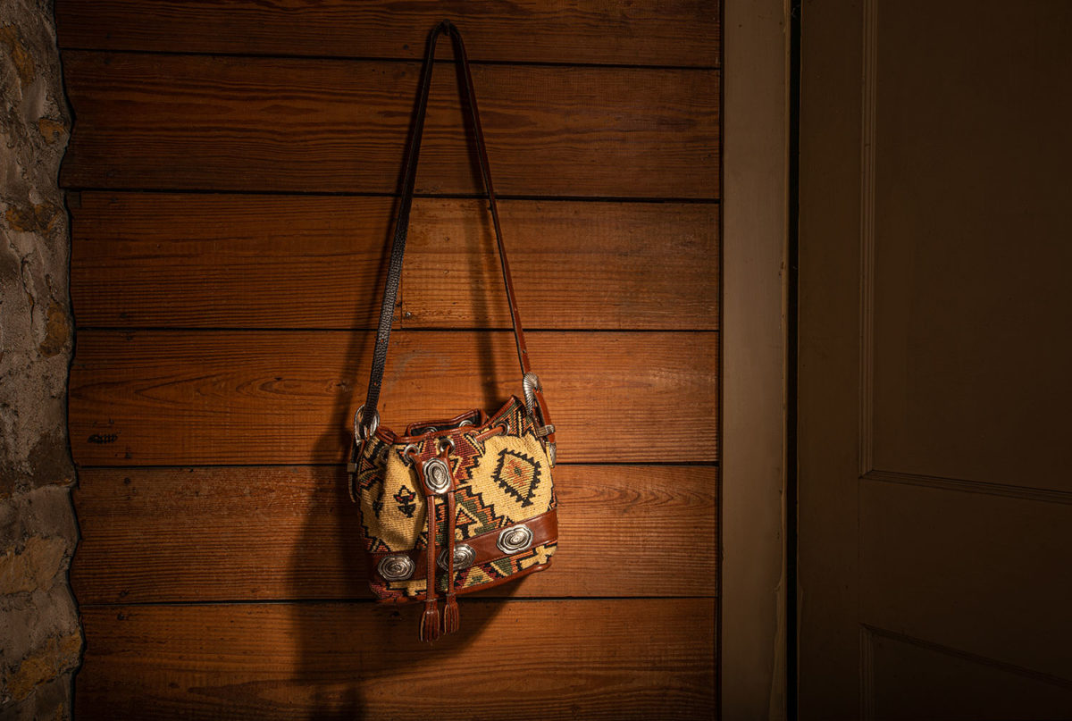 Southwestern purse hanging on a wooden wall