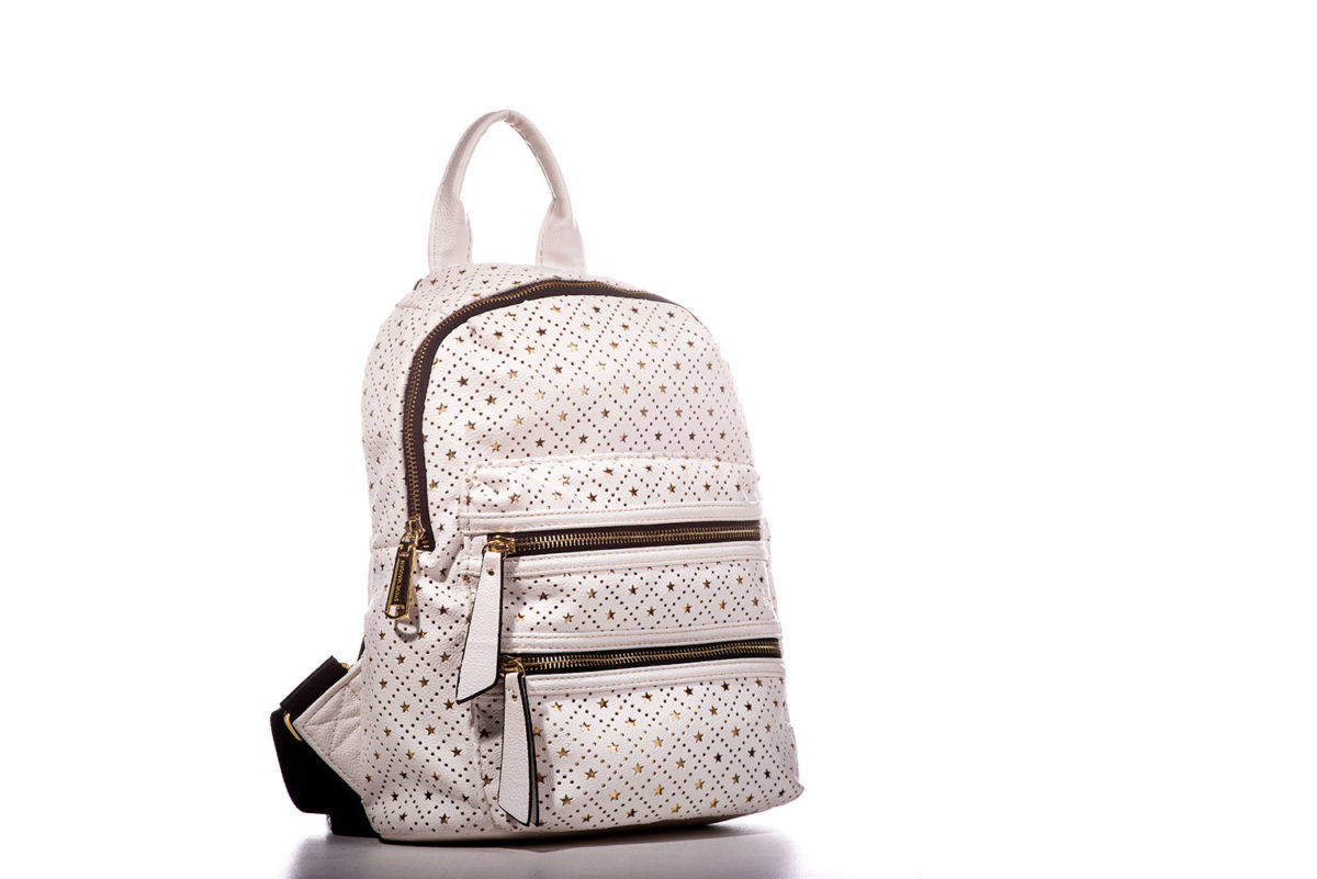 Commercial product shot of a white backpack purse on white