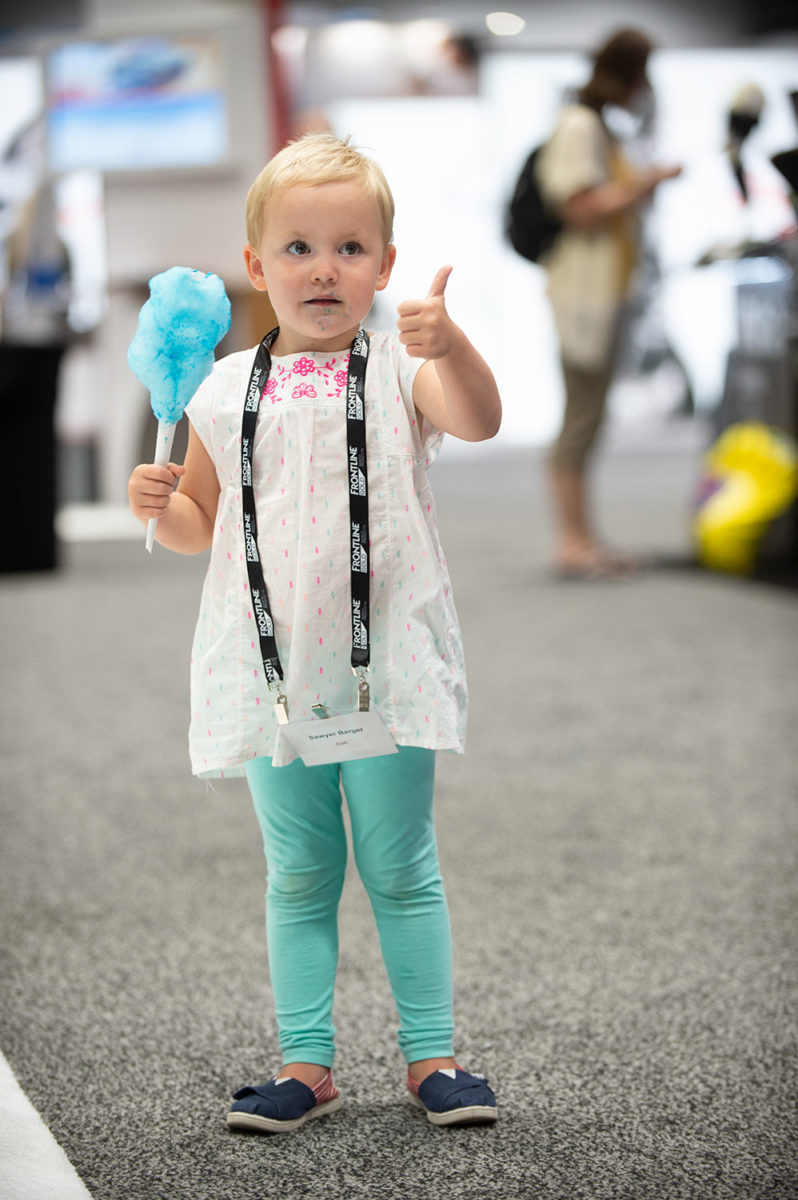 young girl eating cotton candy