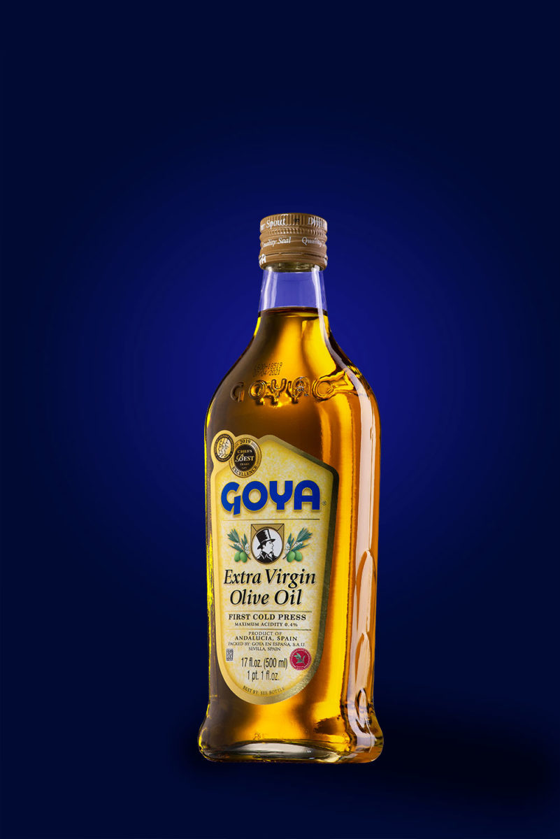 Goya extra virgin olive oil product shot on blue background