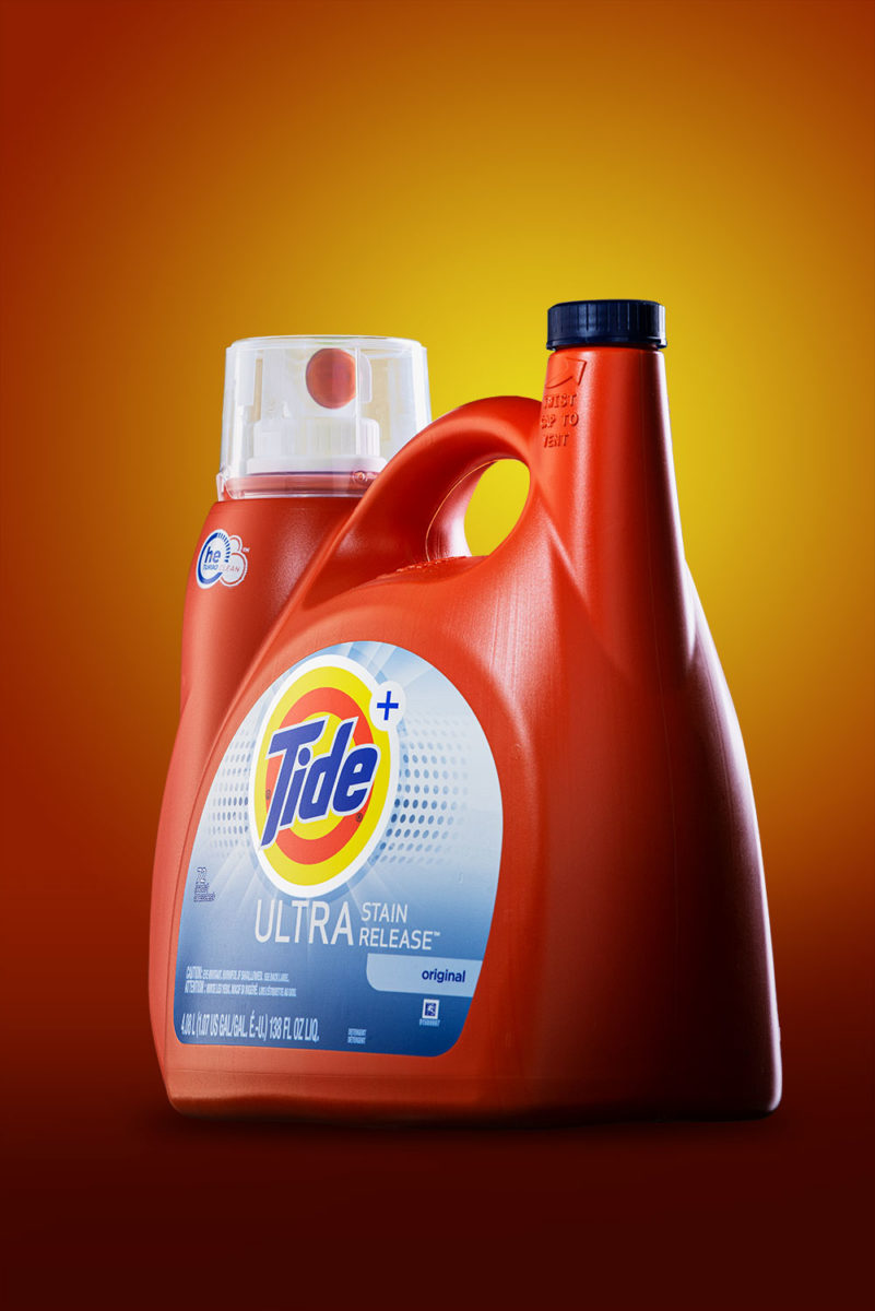 Tide Ultra Detergent on warm orange background