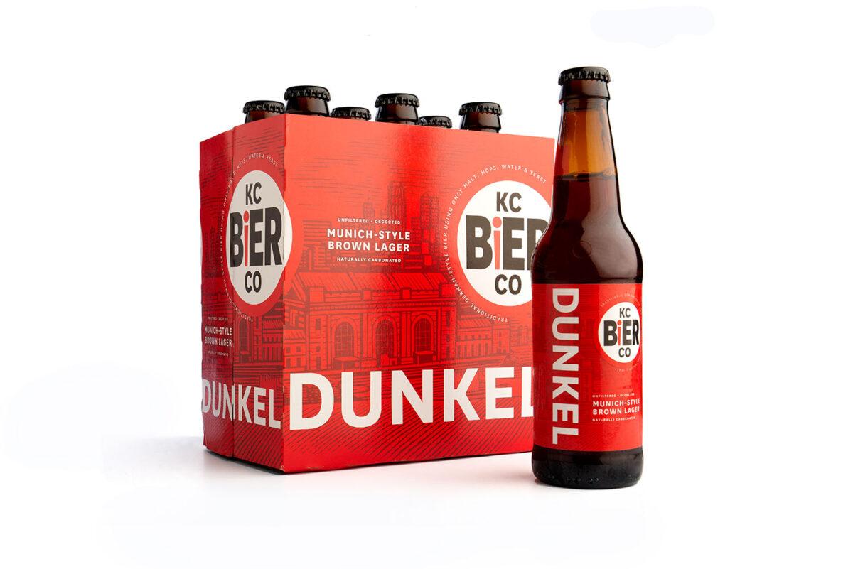 KC Bier Dunkel six pack product shot on white background