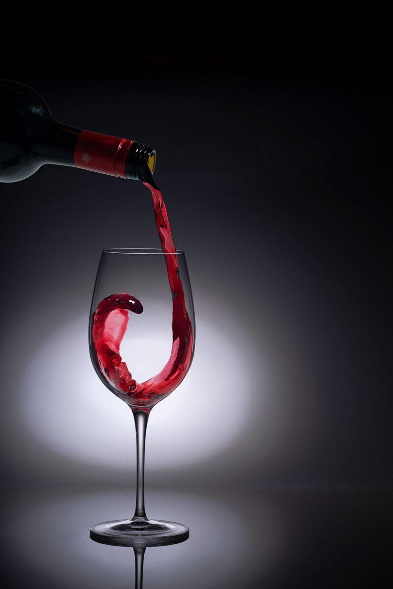 Red wine splashing into a wine glass