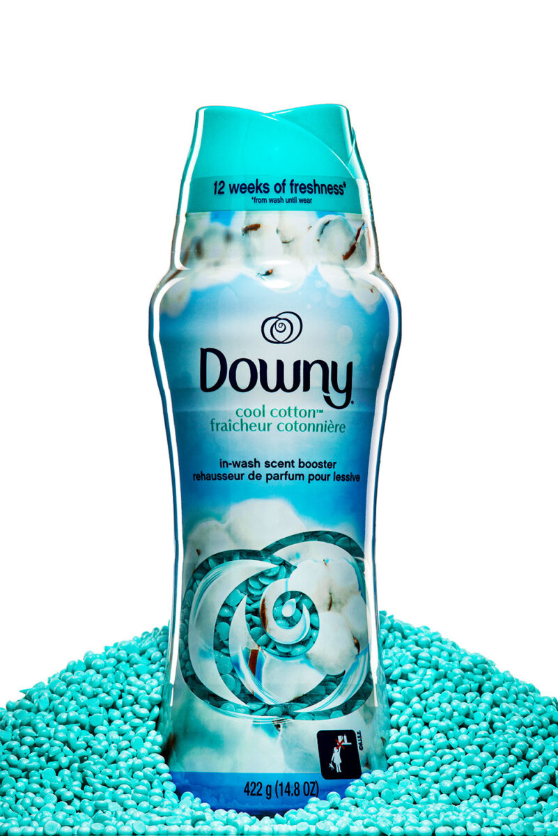 cool cotton Downy Scent Booster bottle sitting in a pile of scent boosters