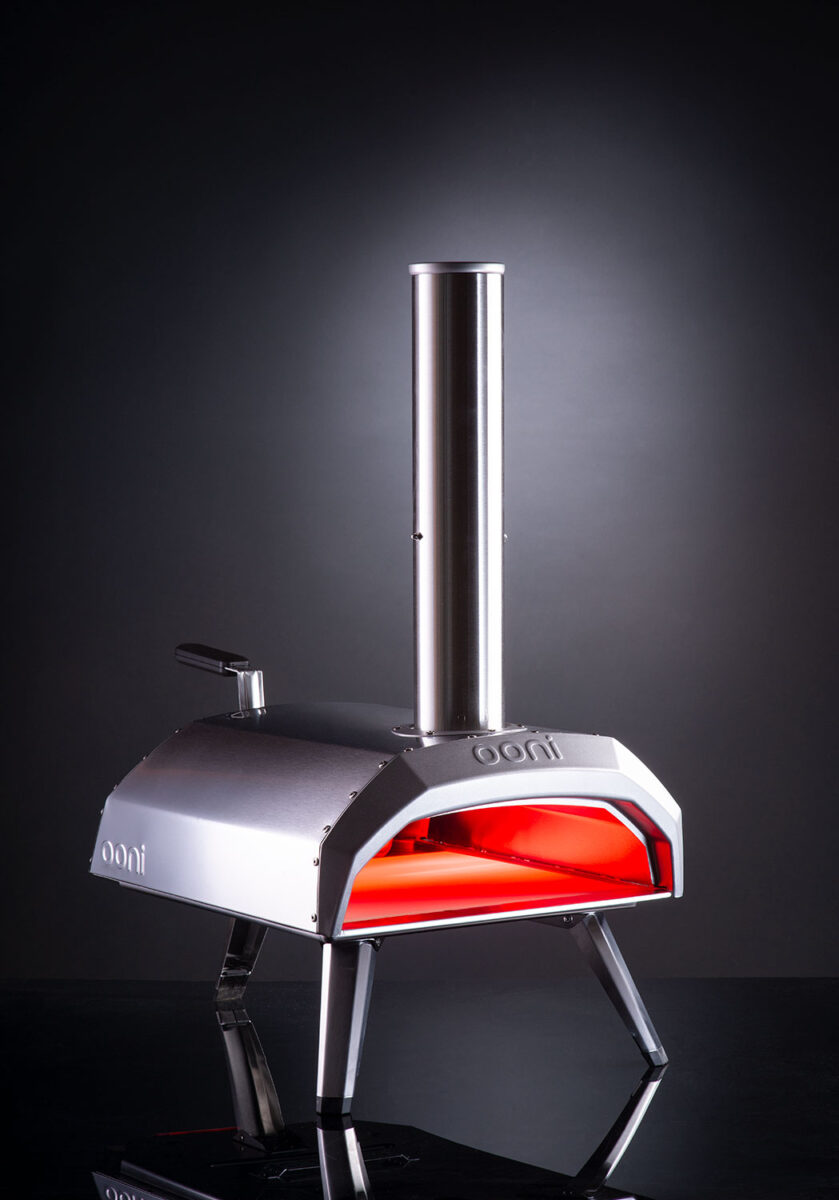 Stainless steel OONI Pizza Oven showing the open front side